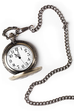 a vintage pocket watch and chain
