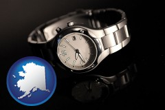alaska map icon and a wristwatch on a black background, with reflection
