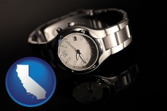 california map icon and a wristwatch on a black background, with reflection