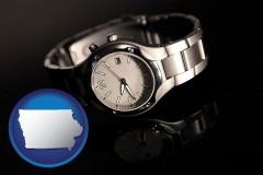 iowa map icon and a wristwatch on a black background, with reflection