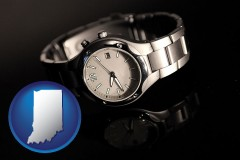 indiana map icon and a wristwatch on a black background, with reflection