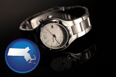 massachusetts map icon and a wristwatch on a black background, with reflection