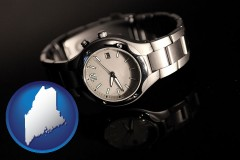 maine map icon and a wristwatch on a black background, with reflection