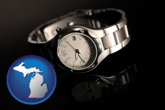 michigan map icon and a wristwatch on a black background, with reflection