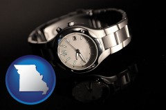 missouri map icon and a wristwatch on a black background, with reflection