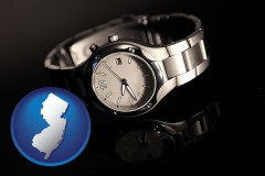 new-jersey map icon and a wristwatch on a black background, with reflection