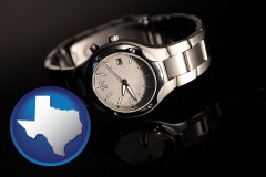 texas a wristwatch on a black background, with reflection