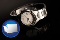 washington map icon and a wristwatch on a black background, with reflection