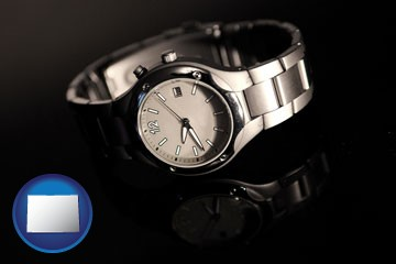 a wristwatch on a black background, with reflection - with Colorado icon