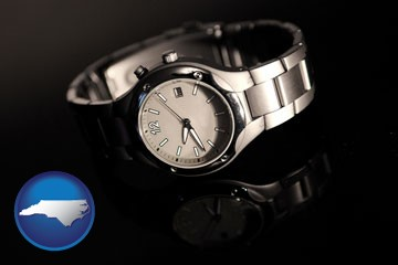 a wristwatch on a black background, with reflection - with North Carolina icon