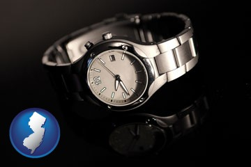 a wristwatch on a black background, with reflection - with New Jersey icon